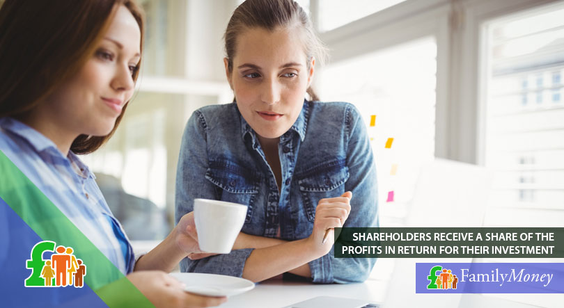 Two ladies looking at their shares and stocks on the laptop