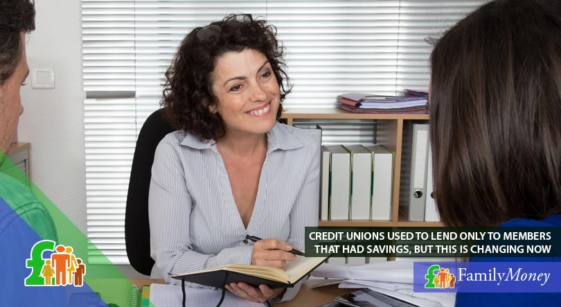 Credit union members discuss ways to borrow and save money at an office