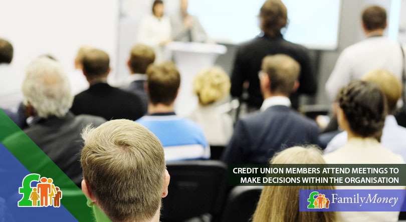 Credit union members attending a meeting about how you can borrow and save money
