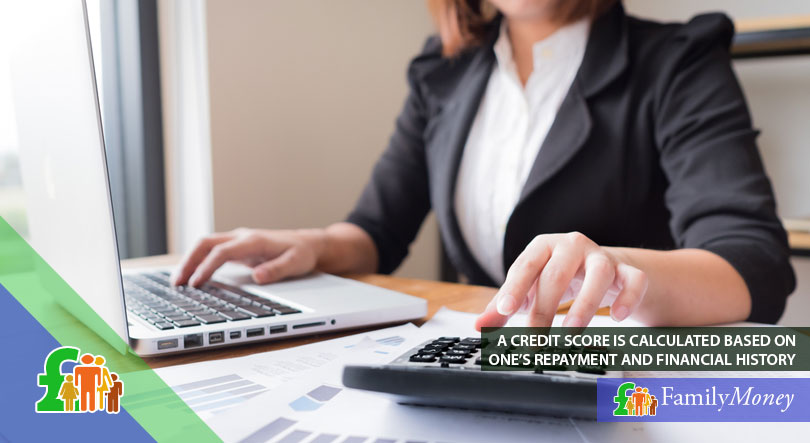A lender sitting at her office calculating credit scores