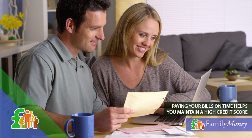A couple paying their bills on time to help them achieve a good credit score