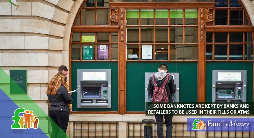 A picture of people withdrawing money from an ATM outside a bank which has used part of its reserve of banknotes to refill the ATMs
