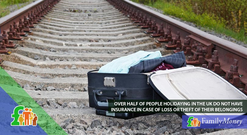 A lost suitcase is lying on railway tracks. It's owner may be insured for its loss.