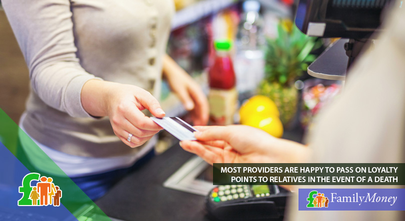 A woman is paying at the supermarket using her loyalty card