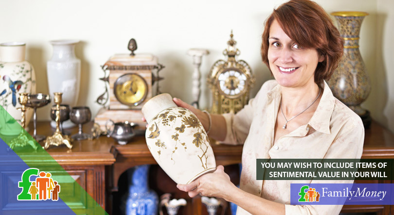 A woman is holding a vase of sentimental value to her