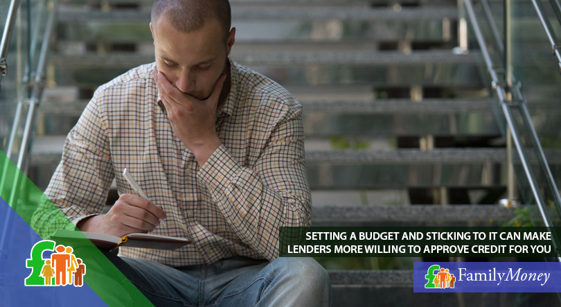 A man is listing his expenses and setting a budget so that lenders will be more willing to approve credit for him