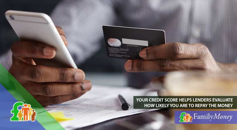 A man is making an online payment to avoid risking a bad credit score