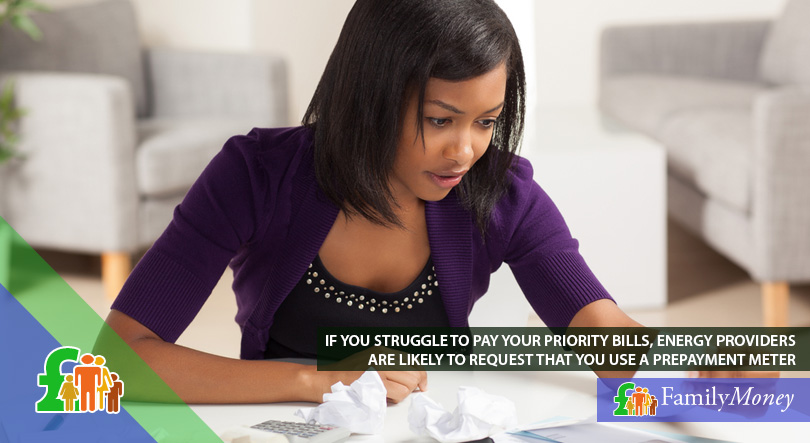 A woman who is sorting through her priority bills so she won't miss an important payment