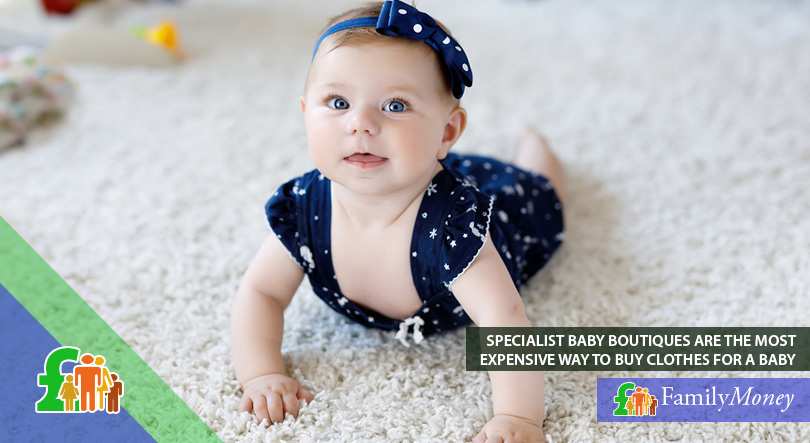 A baby wearing clothes from a specialist boutique is crawling on the floor