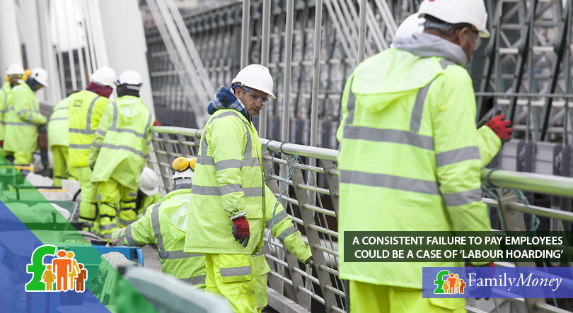 A group of workers are working construction on a central London bridge