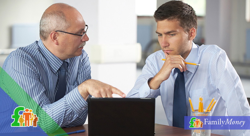 A young employee is discussing his employment contract with a senior manager