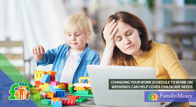 A mother is sitting on her laptop doing work while her child plays next to her