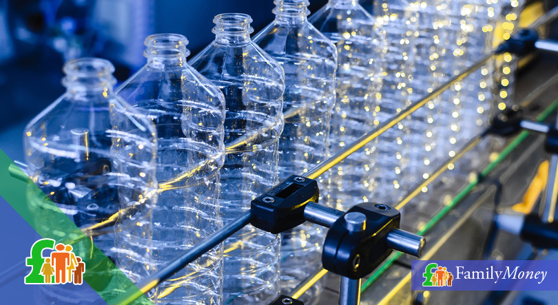 A picture of plastic bottles being manufactured
