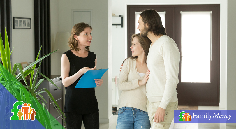 A couple are being shown around a house by a real estate agent