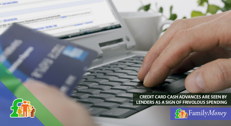A man is shown shopping online on his laptop paying with a credit card