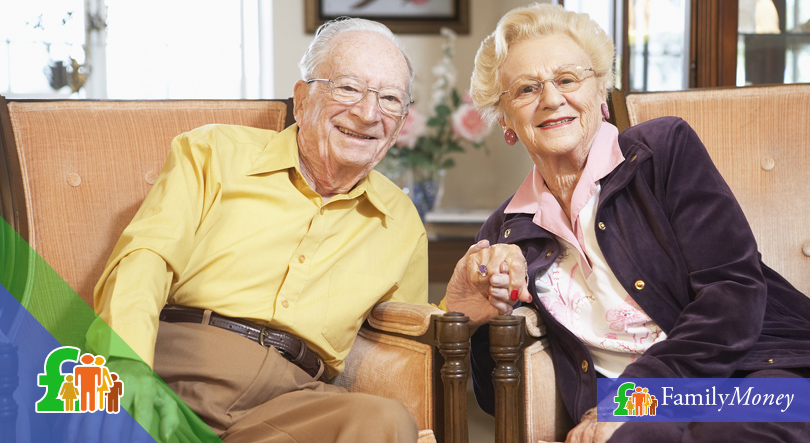 An elderly couple depicted holding hands