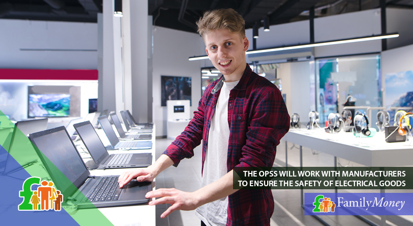 A young man is purchasing a laptop at an electronics store