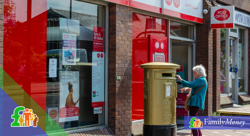 An elderly lady is posting a letter at the post office