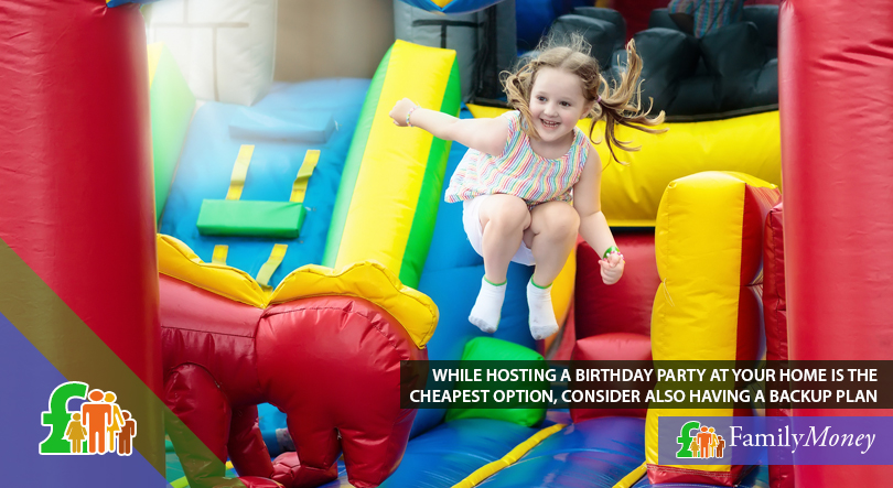 A girl is playing and jumping on a bouncy castle