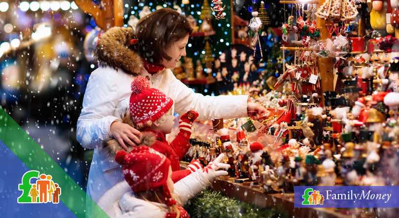 Mother and child choosing presents for Christmas - Family Money