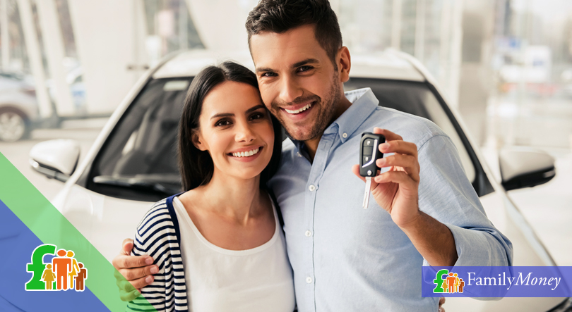 A young couple are shown holding the keys to their new car