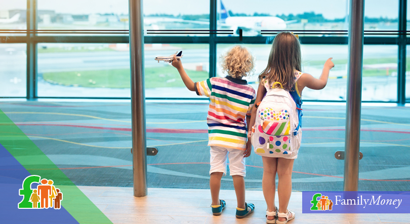 A pair of children are shown waiting for their flight at an airport lounge