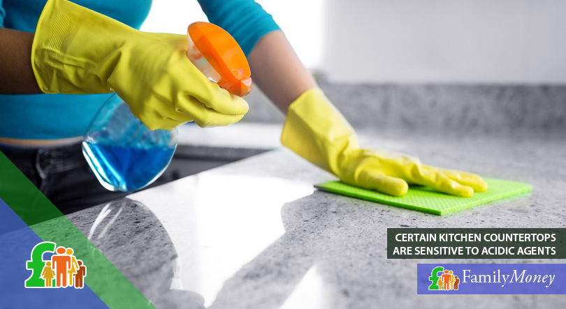 A woman is shown cleaning a kitchen counter top