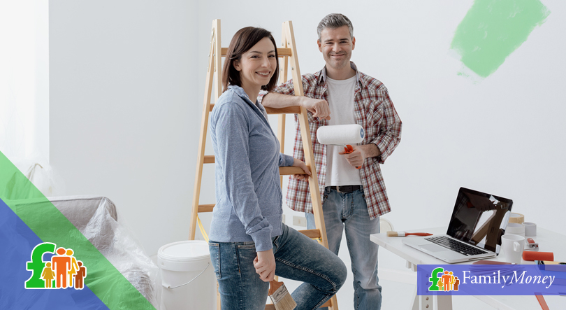 A couple are working on home improvement by painting their home
