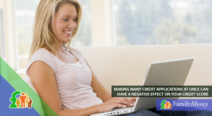 A woman is shown making credit applications on her laptop at home