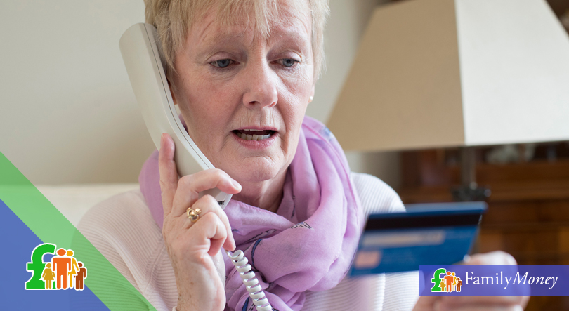 An elderly lady is shown reading out her credit card number on the phone