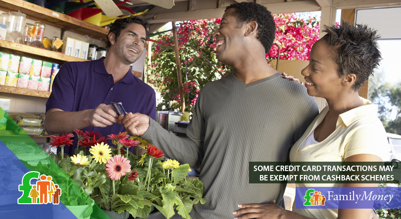 A couple are shown using a credit card at a flower shop