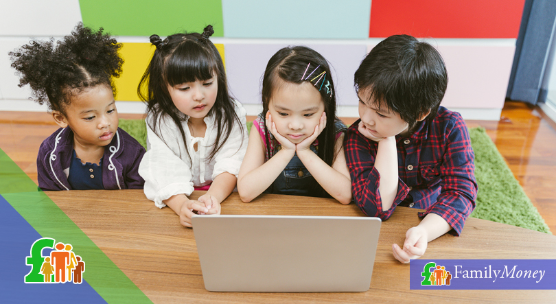 Four children are shown browsing online on a laptop