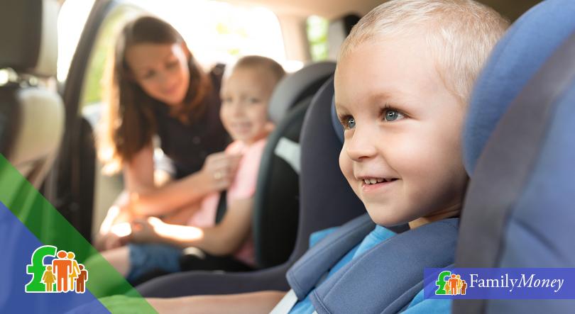 Children sitting in a car - Family Money
