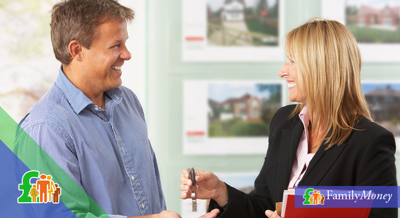 An estate agent is shown speaking with their customer