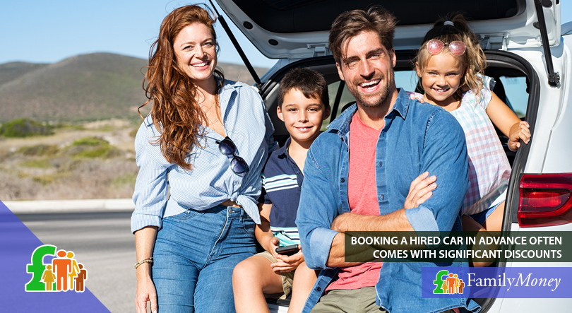 A family on holiday are standing beside a hired car