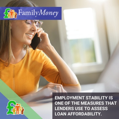 """A woman is shown is working in an office environment while talking on the phone with a loans company - FamilyMoney"